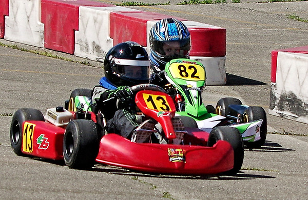 Mark Maynard | for The Herald Bulletin<br /> Five-year old drivers Tiyon Chatman of Anderson (#13) and Gage Harden of Nashville (#82) race down the front straightaway at the Mayor's Cup Grand Prix Kart race on Saturday.