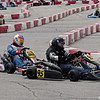 Some close-quarters action during the Mayor's Cup Grand Prix kart races.