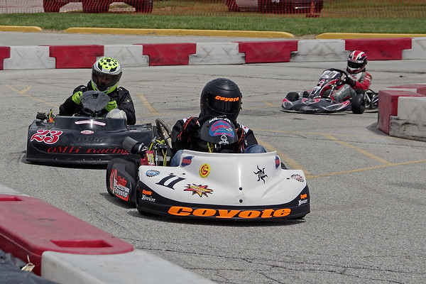 Drivers race onto the back straightaway on the Mayor's Cup Grand Prix track at the Mounds Mall.