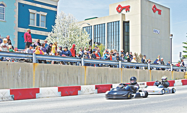 Spectators line Central Avenue to watch the racing action at the Mayor's Cup Grand Prix on Sunday afternoon.
