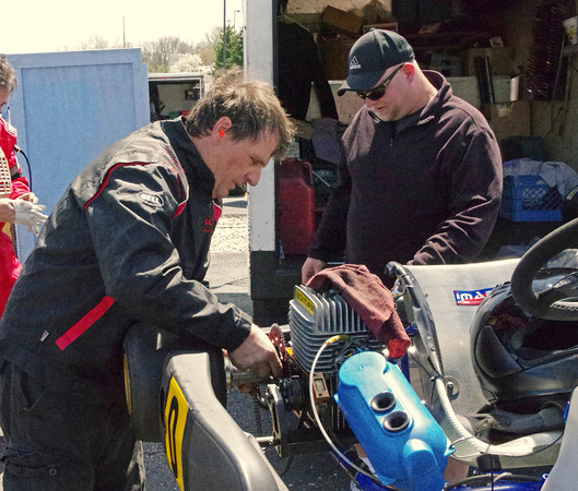 Driver Gary Monnett and Barry Medarais change the gear ratio on Monnett's Yamaha kart prior to his race in the Mayor's Cup Grand Prix on Sunday.