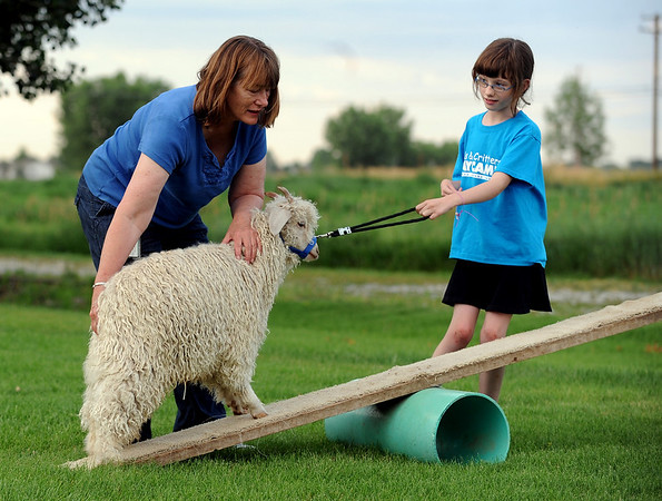 Sue Struthers, left, helps her daughter, Kenzie with her goat showing.<br /> Participants in Boulder County 4-H practiced showing goats at the home on Tina Pohlmann of Erie.<br />  Cliff Grassmick / July 24, 2010