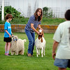 Ryan Abfalter, left, Kenzie Struthers, Terrell Pohlmann, and Taylor Abfalter, watch for  goat showing instructions from Tina Pohlmann.<br /> Participants in Boulder County  4-H practiced showing goats at the home on Tina Pohlmann of Erie.<br />  Cliff Grassmick / July 24, 2010