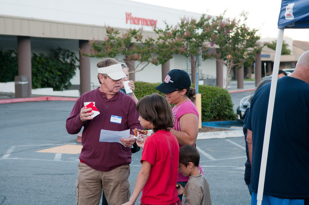 A volunteer receiving some last minute instructions from mom.