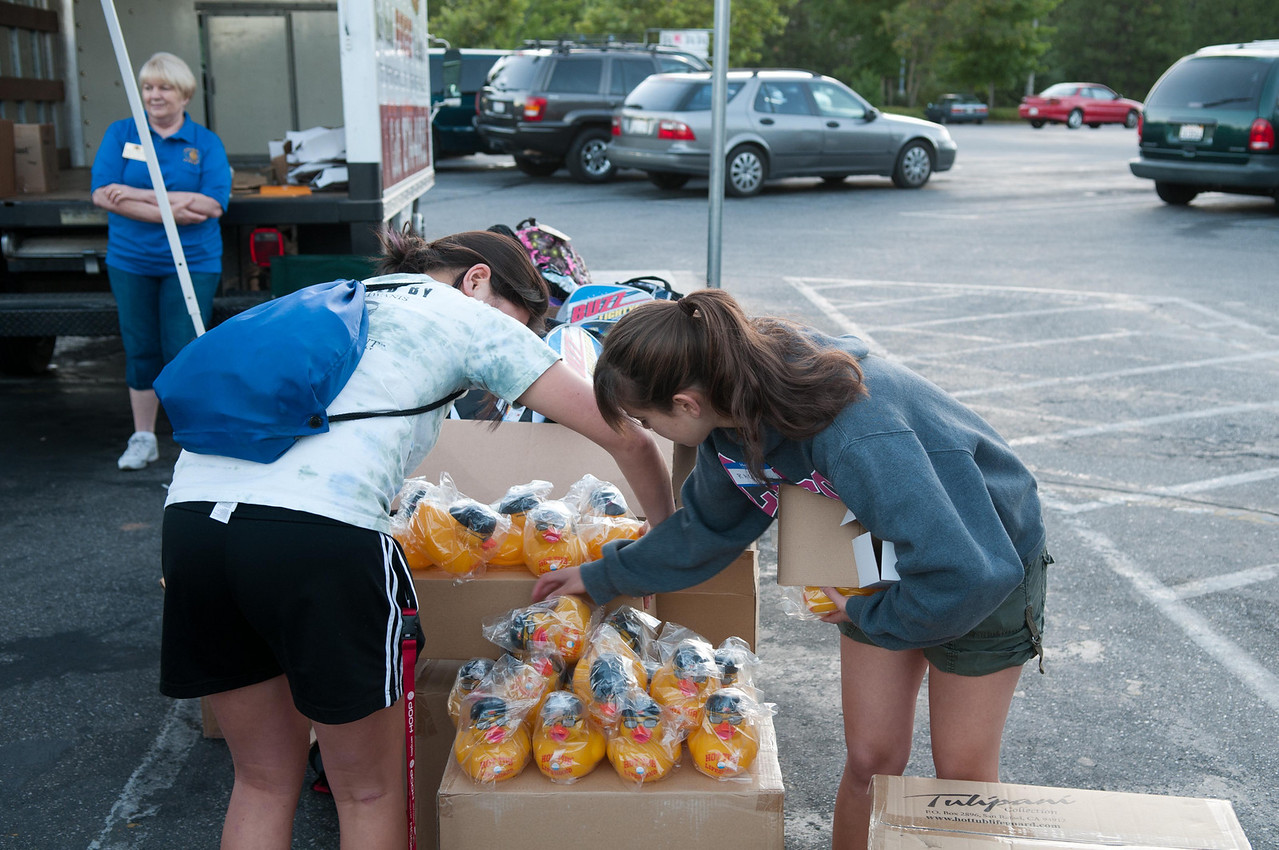 Nevada Union Key Club members Jade and Rachel helped organize and supervise the handout of backpacks with school supplies, rubber duckies and teddy bears.<br /> Thanks for all your help!