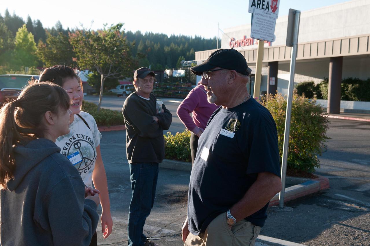 Kiwanian President Robert Crabb talks with Nevada Union Key Club members Rachel and Jade.