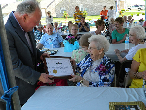 Mayor Gary Herbert presenting Goldia Miller a certificate of congratulations for her 100th birthday.