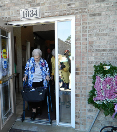 Goldia Miller as she headed outside to attend her 100th birthday party at Crown Point Senior Living Community.