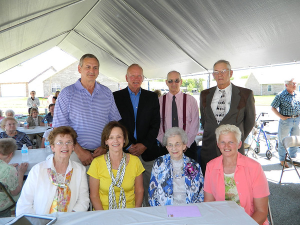 Goldia Miller and her children at her 100th birthday party. <br /> Front row left to right: Arlene Parker, Peggy Weil, Goldia Miller, Sue Hahn<br /> Back row left to right: Doug Miller, Dyar Miller, Larry Miller, Jim Miller