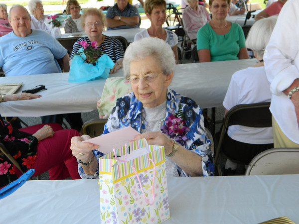 Goldia Miller opening a gift at her 100th birthday party.
