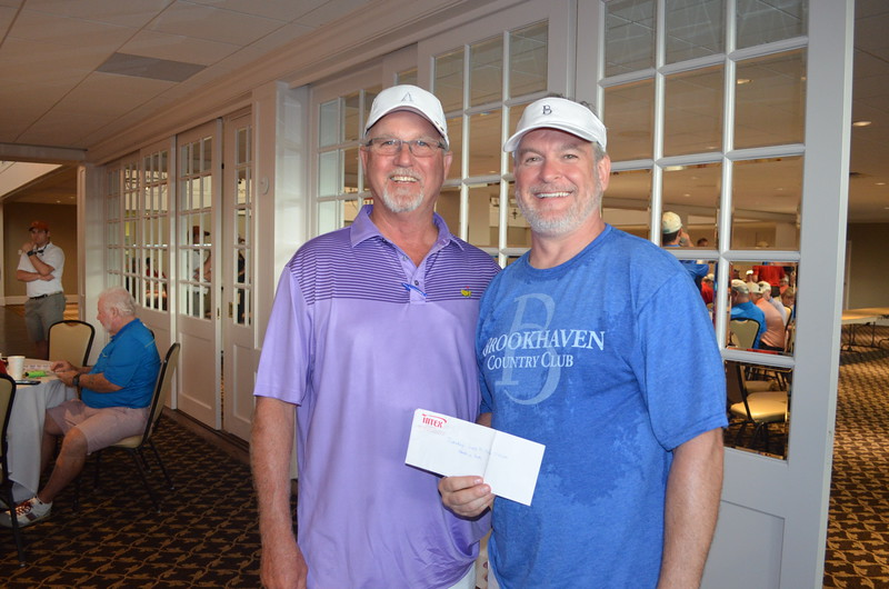 Chris Blackburn of Texas Counter Fitters won two tickets to a Texas Rangers game, courtesy of Greg Paschall of Intex Electric.
