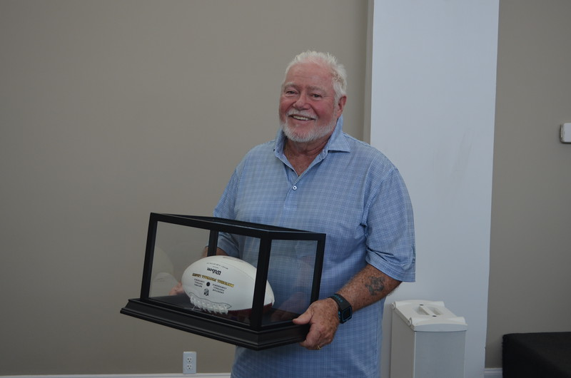 Representatives from Altura Homes also sold raffle tickets for two footballs autographed by Robert Griffin III. Proceeds will benefit the Operation Finally Home project being constructed by Altura Homes in Greenville for Sgt. Rivas. Mike Sugrue of StoneLeaf Homes of Distinction was one of the lucky winners.