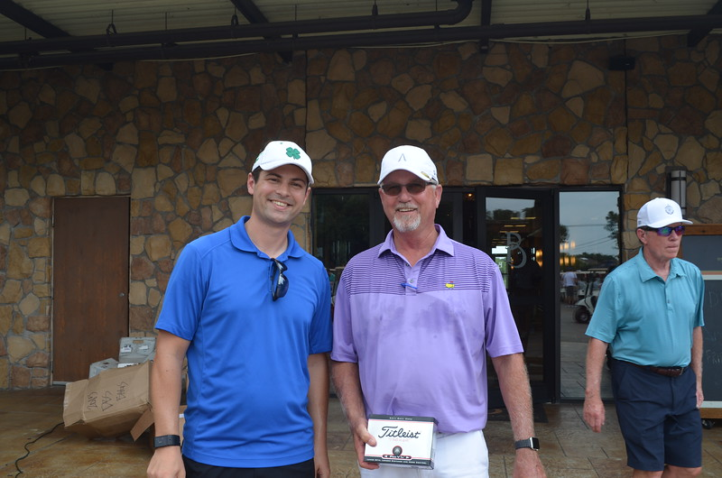 Dallas BA EO Phil Crone & Greg Paschall of Intex Electrical Contractors. Greg won first place in a putting contest held before the tourney benefiting HOMEPAC.