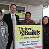 Thrivent Builds with Habitat for Humanity: (L to R), Jose Esteban Gomez, Brian Thirion, Jose & Rafaela Gomez on the front porch of their new Moose Trail home.