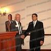 Chairman Joe Emanuele congratulates special honoree retired supervisor Bob McMahon
