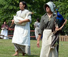 Gayle Jones (R) holds a peacock and Courtney Gehret a duck as they participate in the Grand Fantastical Parade around the plantation grounds during the Goschenhoppen Historians' 48th annual Folk Festival on Friday August 8,2014. Photo by Mark C Psoras