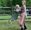 Magen Perelli ,13, spins around friend Evie Grim ,3, as they play during the Goschenhoppen Historians' 48th annual Folk Festival on Friday August 8,2014. Photo by Mark C Psoras