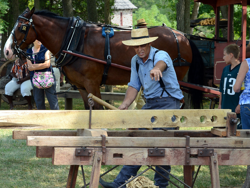 Wood-working demontrations are given during the Goschenhoppen Historians' 48th annual Folk Festival on Friday August 8,2014. Photo by Mark C Psoras