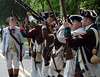 Revolutionary War reenactors with the 1st Continental Regimen perform a firing demonstration during the Goschenhoppen Historians' 48th annual Folk Festival on Friday August 8,2014. Photo by Mark C Psoras
