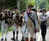 Revolutionary War reenactors with the 1st Continental Regimen lead the way for a parade during the Goschenhoppen Historians' 48th annual Folk Festival on Friday August 8,2014. Photo by Mark C Psoras