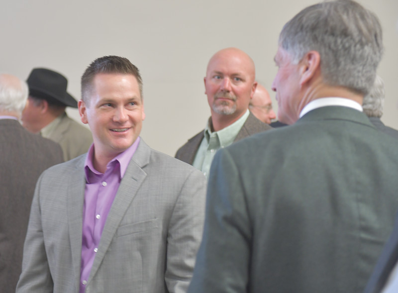Ryan Patterson | The Sheridan Press<br /> Sen. Bo Biteman, R-Ranchester, left, talks with Wyoming Gov. Mark Gordon after an update about the Sheridan Economic and Educational Development Authority at Sheridan College Tuesday, April 16, 2019.