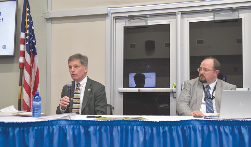 Ryan Patterson | The Sheridan Press<br /> Wyoming Gov. Mark Gordon, left, speaks while Sheridan Economic and Educational Development Authority administrator Robert Briggs looks onduring an update on SEEDA at Sheridan College Tuesday, April 16, 2019. Gordon and Briggs discussed the relationship between education and business communities, how to attract and keep entrepreneurs in Wyoming and the potential of blockchain technology.