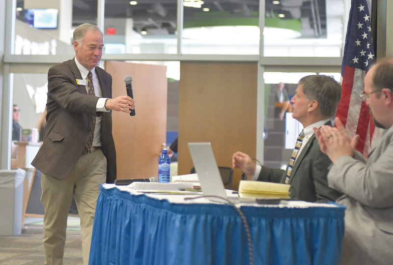 Ryan Patterson | The Sheridan Press<br /> Sen. Dave Kinskey, R-Sheridan, hands a microphone to Wyoming Gov. Mark Gordon during an update about the Sheridan Economic and Educational Development Authority at Sheridan College Tuesday, April 16, 2019.