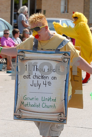 -Messenger photo by Hans Madsen<br /> <br /> Babs Dawster, of Fort Dodge, passes on the wisdom of the Eleventh Commandment Thursday while marching in the annual Gowrie Fourth of July parade. Her church, Gowrie United Methodist, serves chicken as part of the festivities.