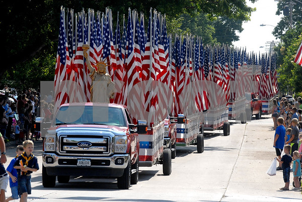 -Messenger photo by Hans Madsen<br /> <br /> The Gowrie Fourth of July parade featured six floats full of flags, each flag honors an area veteran.
