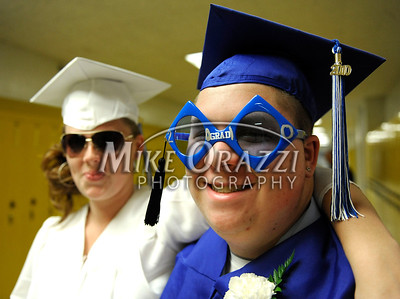 6/18/2010 Mike Orazzi | Staff Southington High School students Erika Cleveland and Gregory Cop shot off their sunglasses at Friday evening's graduation ceremony.