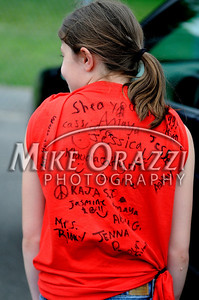 6/16/2010 Mike Orazzi | Staff Bingham School student Christine Libbey shows off her signed t-shirt outside the school on the last day of classes for the Clarence A. Bingham school.