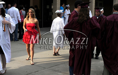 6/16/2010 Mike Orazzi   Staff  Bristol Central High School graduates Kayla Brown wades through classmates wearing their caps and gowns outside the school auditorium on Wednesday evening.