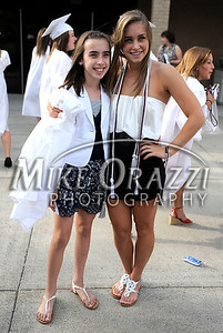 6/16/2010 Mike Orazzi | Staff  Bristol Central High School graduate Jessica Blauvelt (right)  and her sister Rachel pose for a photograph taken by their dad Peter at the Central graduation on Wednesday evening.