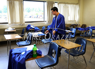 "6/18/2010 Mike Orazzi | Staff Southington High School student Jonathan ""Gordy"" Gworek gets ready for Friday evening's graduation ceremony."