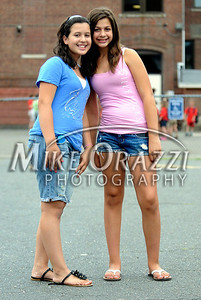 6/16/2010 Mike Orazzi | Staff Former Bingham School students Cindy Tema (left) and Hailee Velazaquez pose outside the school on the last day of classes for the Clarence A. Bingham school.