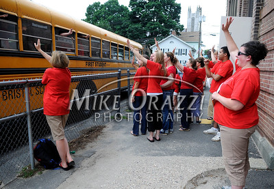 6/16/2010 Mike Orazzi   Staff Bingham School teachers and staff wave to students on busses on the last day of classes for the Clarence A. Bingham school.