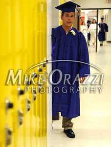 6/18/2010 Mike Orazzi | Staff Southington High School student Matt Angelillo gets ready for Friday evening's graduation ceremony.