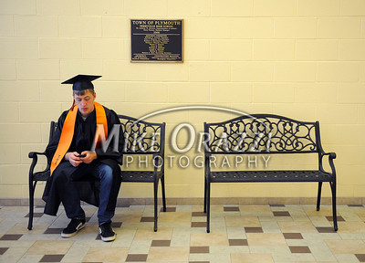 6/15/2011 Mike Orazzi | Staff Terryville High School Senior Jacob Henry texts his girlfriend before the start of the graduation ceremony on Wednesday night.