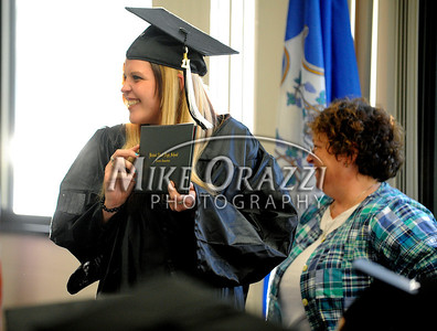 5/25/2011 Mike Orazzi | Staff Terrin Carrara shows off her diploma during the graduation ceremony at the Bristol Adult Education Center on Redstone Avenue in Bristol on Wednesday night.