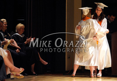 6/15/2011 Mike Orazzi Terryville High School graduates and cousins Sarah Casola and Brianna Lassy hug during Wednesday night's graduation ceremony at THS.