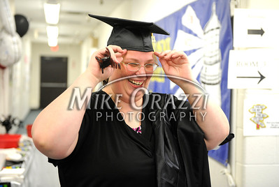 5/25/2011 Mike Orazzi | Staff Amy Gagnon adjusts her cap before the start of the graduation ceremony at the Bristol Adult Education Center on Redstone Avenue in Bristol on Wednesday night.