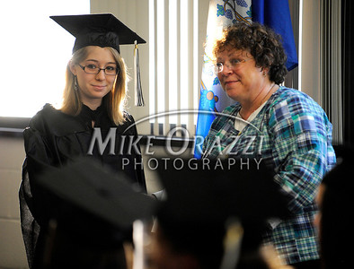 5/25/2011 Mike Orazzi | Staff Amanda Jacobsen shakes hands with deputy superintendent Sue Moreau  during the graduation ceremony at the Bristol Adult Education Center on Redstone Avenue in Bristol on Wednesday night.