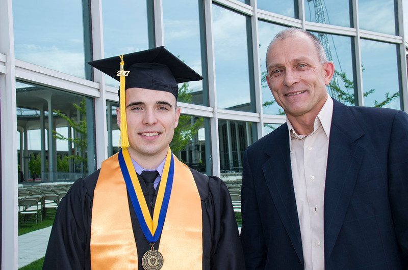 Chemistry major Mathew Boll (Lynbrook, N.Y.) and professor Igor Lednev.  Photo: Mark Schmidt