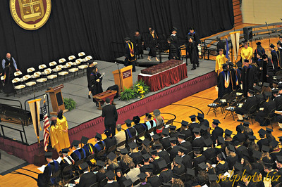 """http://www.morris.umn.edu/newsevents/view.php?itemID=12587  2013 Commencement Ceremony Held in the P.E. Center  Posted by Jenna Ray on Tuesday, Apr. 30, 2013  Event Date/Time: Saturday, May. 11, 2013 1:30 pm Location: P.E. Center   Nearly 350 University of Minnesota, Morris students will receive their degrees during the 50th Commencement on Saturday, May 11. The ceremony will take place in the P.E. Center at 1:30 p.m. The public is invited to attend the ceremony, to watch the event streamed online, or to listen on KMRS/KKOK radio.  The Symphonic Winds, under the direction of Simon Tillier, teaching specialist of music, and the Concert Choir, under the direction of Christina Armendarez, assistant professor of music, will perform prior to and throughout the ceremony Accompanied by Symphonic Winds, Mary Preus '13, Mayville, North Dakota, will sing """"The Star Spangled Banner."""" In recognition of the campus's origins as an American Indian boarding school, the Midnite Express Singers will perform a Native American Honor Song to recognize and pay tribute to the Class of 2013.  Chancellor Jacqueline R. Johnson will provide the welcome and recognition of special guests, and University of Minnesota Regent Thomas Devine will give additional remarks. As the 2013 recipient of the Curtis H. Larson Award, Holly Gruntner '13, Chisago City, will speak on behalf of the graduates.  United States Senator Al Franken will provide the graduation address. Senator Franken was elected to the United States Senate in 2008 as a member of the Democratic-Farmer-Labor (DFL) Party from Minnesota. He is a long-time advocate for affordable, accessible health care, an economy that works for the middle class, the protection of a secure retirement, the promise of a twenty-first century education for children, and the creation of a green economy that creates jobs and improves the environment.  After the conferring of degrees, University of Minnesota, Morris Alumni Association president Suzanne Hendricks Ba"""