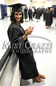 5/18/2012 Mike Orazzi | Staff CCSU graduate Maria Karahalios texts a friend while at the commencement exercise held at the XL Center in Hartford on Friday night.