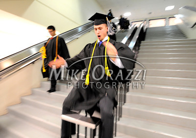 5/18/2012 Mike Orazzi | Staff CCSU graduate Rob Lee, Plainville, slides down the railing while at the commencement exercise held at the XL Center in Hartford on Friday night.