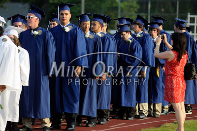 6/20/2012 Mike Orazzi | Staff  Plainville High School graduates make their way to their seats during the graduation ceremony on Wednesday night at Alumni Field.