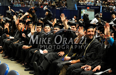 5/18/2012 Mike Orazzi | Staff CCSU graduate wave to family and friends while at the commencement exercise held at the XL Center in Hartford on Friday night.