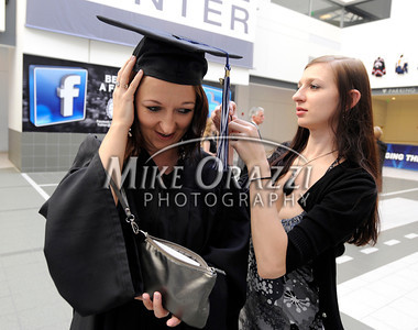 5/18/2012 Mike Orazzi | Staff CCSU graduate Magdalena Fiorek, New Britain, gets some help with her cap from her sister Gosia at the commencement exercise held at the XL Center in Hartford on Friday night.