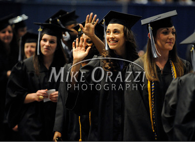 5/18/2012 Mike Orazzi | Staff CCSU graduate Samantha Halladay waves to family and friends while at the commencement exercise held at the XL Center in Hartford on Friday night.